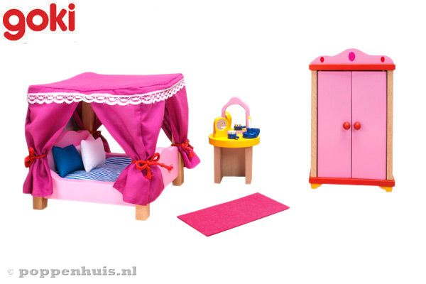 Roze slaapkamer met hemelbed van Goki.